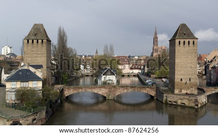 scenery in Strasbourg with bridge over the rhine and big towers made of stone (Alsace/France) - stock photo