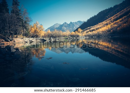 Scenery of high mountain with lake and high peak on a clear day. Pure mountain water. Clear mountain lakes in the Alpine area. - stock photo