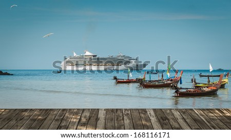 scenery of patong beach with long tail boats and luxury cruise on andaman sea, thailand - stock photo