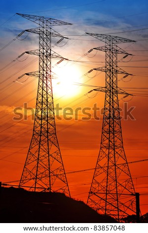 Scenery of silhouetted electrical tower during sunset - stock photo