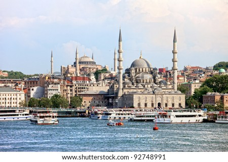 Scenery of the Eminonu district in the city of Istanbul in Turkey with New Mosque and Hagia Sophia at the farther end - stock photo