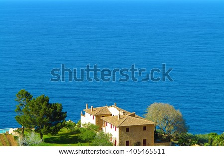 scenery with residential house overlooking the blue sea - stock photo
