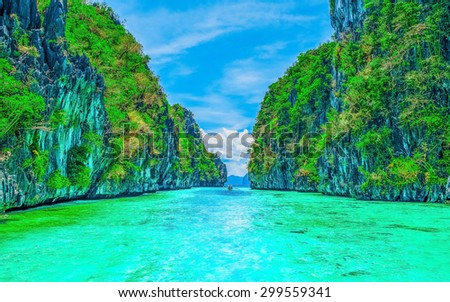 Scenery with tropical rock islands and crystal clear water - stock photo