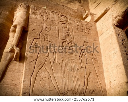 Scenes from the life of Ramses II in low-relief at the entrance of the Abu-Simbel Temple (Egypt) - stock photo