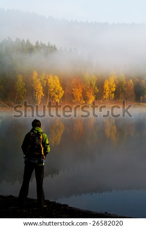 Scenes of hiking in the wild. Early in the morning at a lake. - stock photo