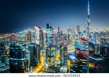 Scenic aerial view of a big modern city at night. Business bay, Dubai, United Arab Emirates. - stock photo
