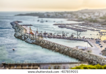 Scenic aerial view of Santa Maria di Leuca waterfront, Salento, Apulia, Italy. Tilt-shift effect applied - stock photo