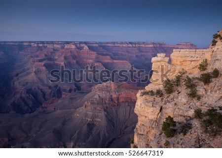 Scenic aerial view of world famous Grand Canyon, considered one of the Seven Natural Wonders of the World, in beautiful post sunset twilight at dusk in summer, Arizona, American Southwest, USA