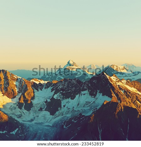 scenic alpine landscape with and mountain ranges. natural mountain background. vintage stylization - stock photo