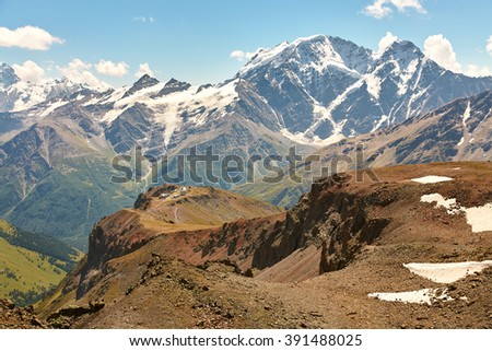 scenic alpine landscape with observatory and mountain ranges. natural mountain background - stock photo