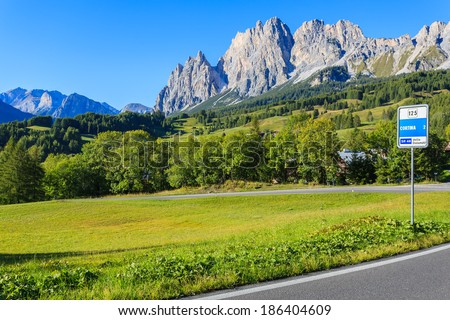 Scenic alpine road with mountains view in summer, Cortina d'Ampezzo, Dolomites Mountains, Italy