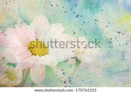 scenic artwork with chamomiles and watercolor splatter - stock photo