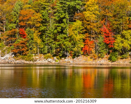 Scenic Autumn Colors Reflected in the water - stock photo
