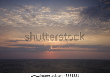 Scenic Bald Head Island North Carolina landscape of sunrise over ocean. - stock photo