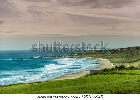 scenic beach landscape in northern ireland - stock photo