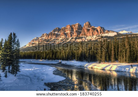 Scenic Bow river and Castle Mountain in winter, Banff National Park Alberta Canada - stock photo