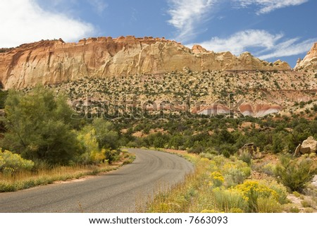 scenic byway running through the red sandstone cliffs along the Burr Trail in Grand Staircase-Escalante National Monument in southern Utah. - stock photo