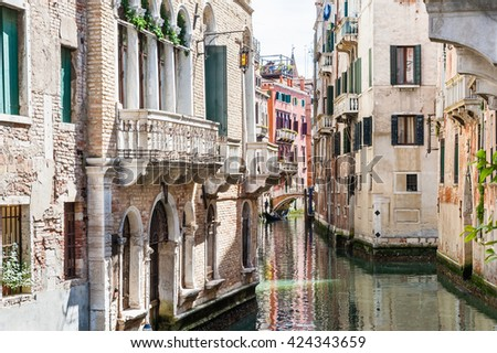 Scenic canal with bridge and ancient buildings in Venice, Italy - stock photo