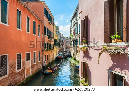 Scenic canal with gondolas and colorful buildings in Venice, Italy - stock photo