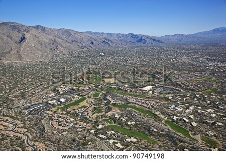 Scenic Catalina Mountains with golf course and resort properties - stock photo