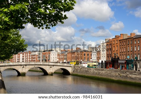 Scenic city of Dublin with an old Mellows Bridge (Queen Maeve Bridge) on the river Liffey in Ireland - stock photo