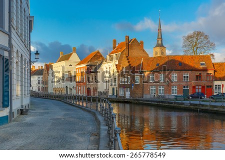 Scenic city view of Bruges canal with beautiful medieval houses and church, Belgium - stock photo