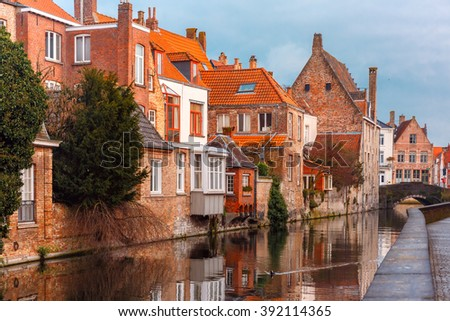 Scenic city view of Bruges canal with beautiful medieval houses and their reflection, Belgium