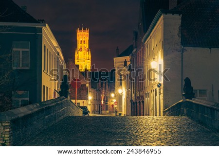 Scenic cityscape with a medieval fairytale town and tower Belfort at night in Bruges, Belgium - stock photo