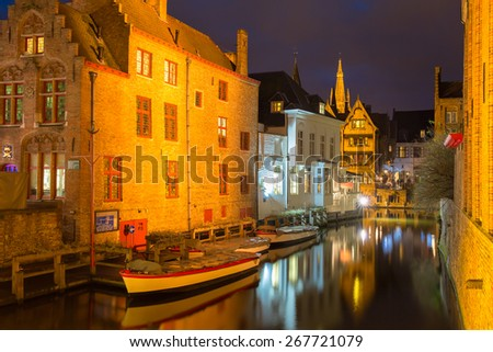 Scenic cityscape with the picturesque night medieval canal Dijver in Bruges, Belgium - stock photo