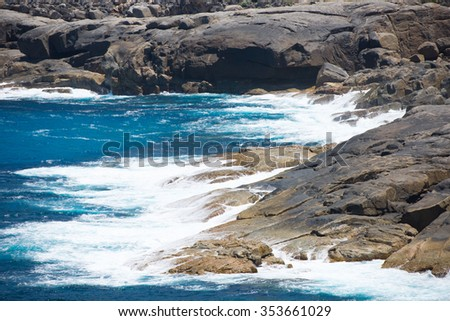 Scenic close up cliff coast of Torndirrup National Park, Albany, Western Australia, wild Southern Ocean, copy space. - stock photo