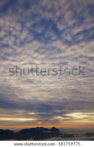 Scenic cloudscape on arctic Lofoten islands in Norway lit by midnight sun