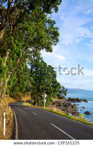Scenic coast road in New Zealand - stock photo
