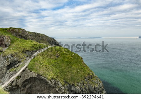 Scenic coastal view along pathway out to Carrick-a-rede rope bridge, Northern Ireland - stock photo