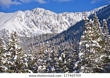 Scenic Colorado Winter Mountains. Alpine Peaks and Forest Covered by Fresh Heavy Snow. Colorado, United States. - stock photo