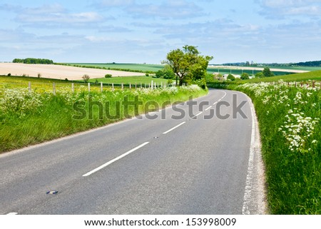 Scenic country road in England - stock photo