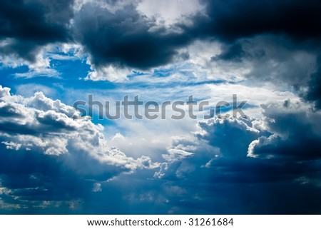Scenic cumulus clouds before a storm - stock photo