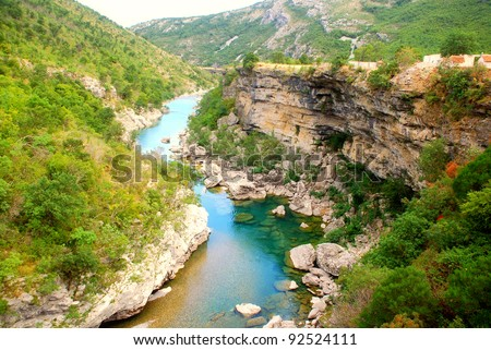Scenic deep canyon with blue Tara river in Montenegro mountains - stock photo