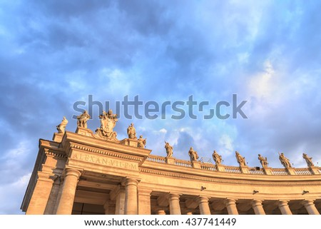 Scenic dramatic sky over the statues and colonnade of St. Peter's Basilica at sunset.Beautiful architectural and natural landscape.Saint Peter Square ( Piazza San Pietro ).Vatican.Rome.Italy.Europe. - stock photo