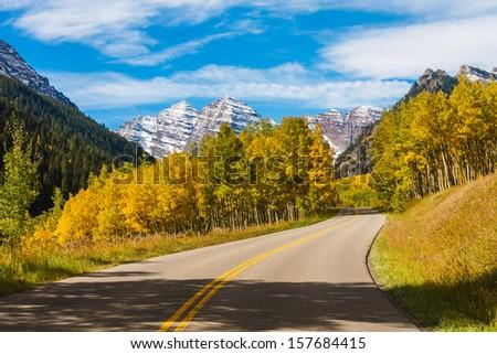Scenic Drive to Maroon Bells in Autumn,Maroon Bells Wilderness, Aspen Colorado - stock photo