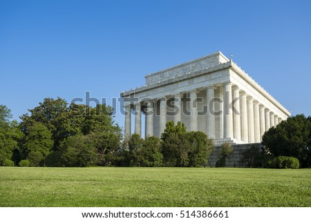 Scenic exterior view of the classical architecture of the Lincoln Memorial in Washington, DC on a bright blue sky summer morning