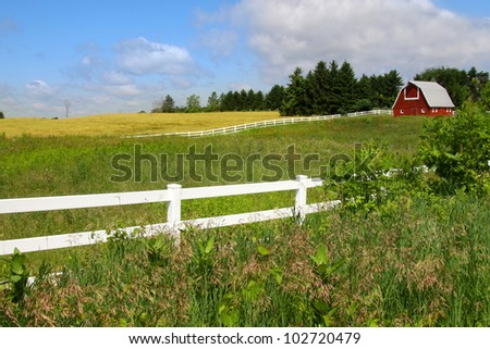 Scenic farm landscape with Barn - stock photo
