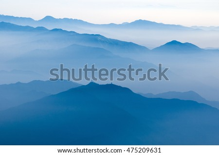 scenic foggy atmosphere above Japanese mountains by early morning