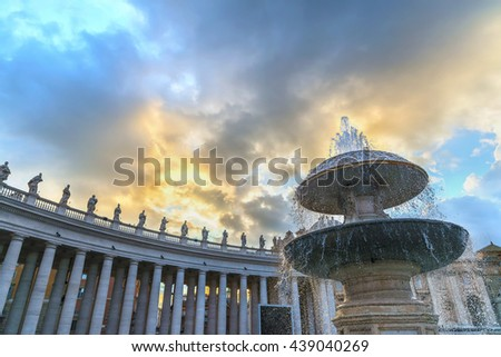 Scenic fountain on the Saint Peter Square (Piazza San Pietro) at sunset against colonnade of the Saint Peter Basilica. Designed by famous sculptor Gian Lorenzo Bernini. Vatican. Rome. Italy. Europe. - stock photo