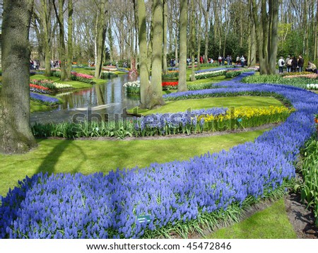 Scenic garden with colorful spring flowers and pond in  dutch spring garden  (Keukenhof, the Netherlands) - stock photo