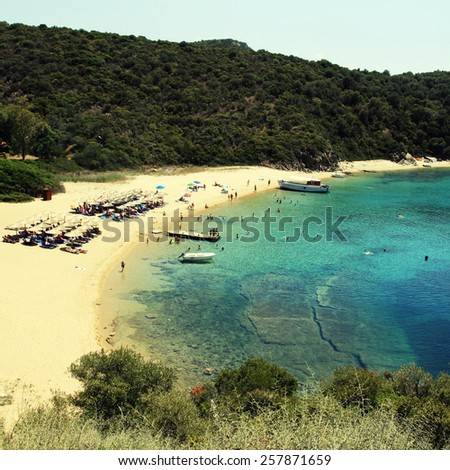 Scenic greek lagoon with sand beach and turquoise Mediterranean sea, Ammouliani Island, Halkidiki, Greece. Square toned image, instagram effect - stock photo