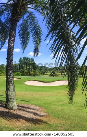 Scenic Green and bunker at 8th hole on Green Valley/St. Andrews golf course near Pattaya, Thailand - stock photo