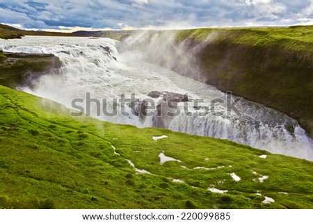 Scenic Gullfoss in Iceland. Water abyss. Over boiling water should cloud splash - stock photo