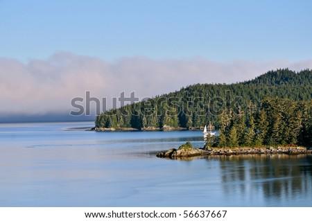 scenic harbor and calm water in alaska - stock photo