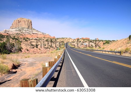 Scenic highway through Navajo Indian reservation in northern Arizona with colorful sandstone rock formations in view