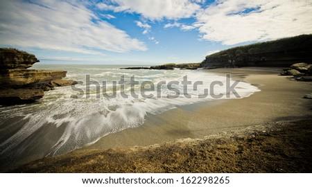 Scenic isolated beach in New Zealand - stock photo